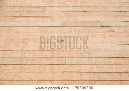 DELHI, INDIA - FEBRUARY 13: Engraved name of the soldiers on the bricks of India Gate on February 13, 2016, Delhi, India. The Indian gate is the national monument of India.