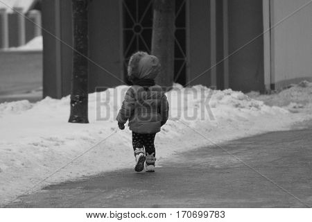 vivid fast move little girl made first steps on slippery street, but dont give up!