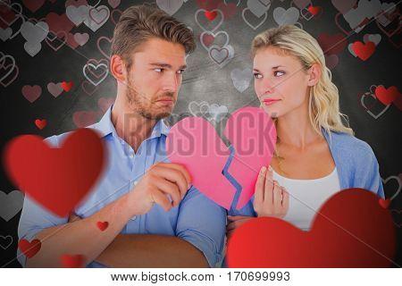 Couple holding two halves of broken heart against love heart, pattern