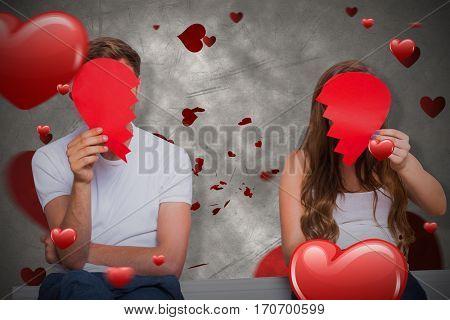 Couple holding broken heart against love heart pattern 3D