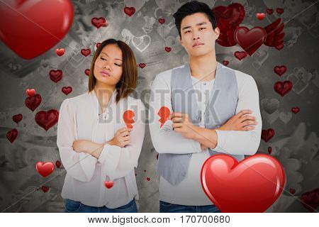 Young couple holding broken heart against love heart pattern 3D