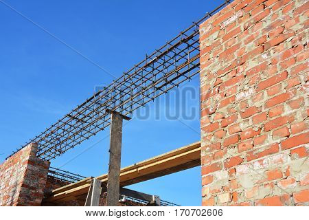Lintel Construction. Rebar steel bars reinforcement concrete bars with wire rod. Brickwork with Iron Bars for Next Floor House Construction Building Brick House Wall.
