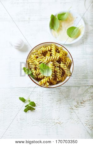 Pasta with basil-green olive pesto and parmesan