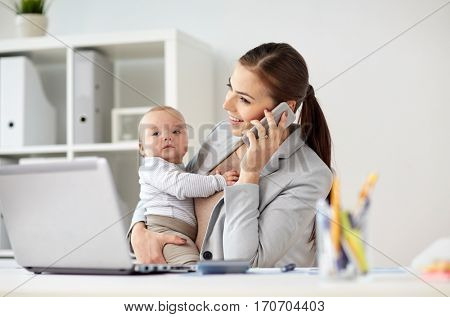 business, motherhood, multi-tasking, family and people concept - happy smiling businesswoman with baby calling on smartphone at office
