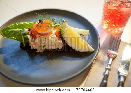 food, new nordic cuisine, culinary and cooking concept - close up of toast skagen with shrimps, fish roe and buttery bread on plate