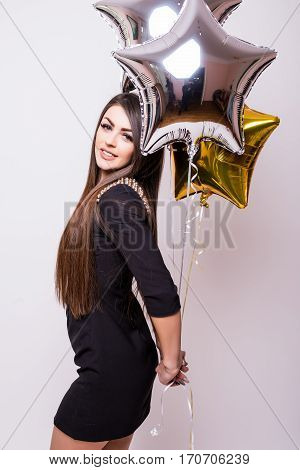 Young beauty girl with balloons on white background