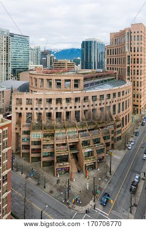 Vancouver Canada - January 28 2017: Vancouver city skyline with the public library in the foreground