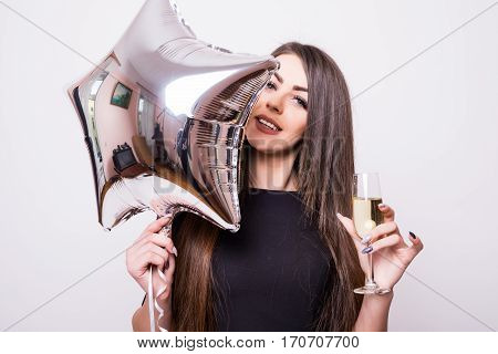 Woman With Star Shaped Balloon Drinking Champagne