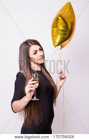 Woman With Star Shaped Balloon Drinking Champagne On White