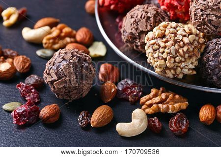 Homemade Candy With Chocolate , Nuts And Dried Strawberry