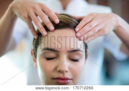 Woman receiving a head massage at spa