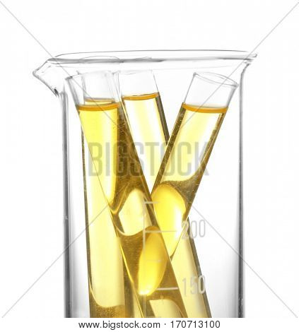 Test tubes with urine in beaker on white background