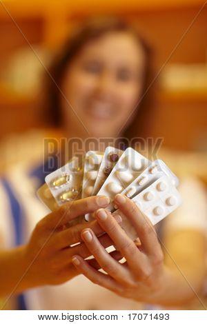 Woman Showing Pills