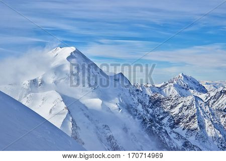Landscape with high mountains covered snow