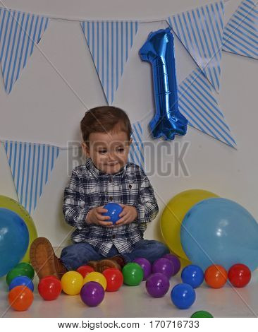One year birthday baby party and balloons.