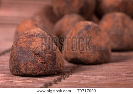 Black chocolate truffles covered with cinnamon powder