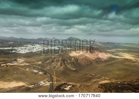 amazing landscape with Lanzarote mountain terrain and dark cloudy sky, Canary island, Spain