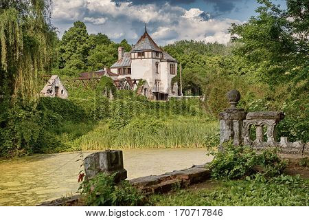 beautiful view of Sharovsky Castle building in amazing green park with lake and sky on the background, Kharkiv region