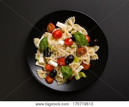 Farfalle Salad On Black Plate