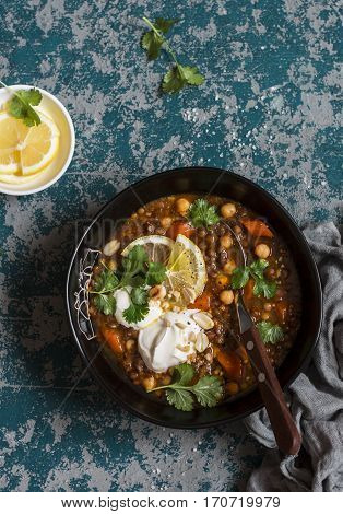 Moroccan lentil and chickpea soup. Vegetarian healthy food concept. Top view