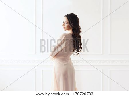 Fashion shoot of beautiful woman in dressing gown. Fashion, vogue, glamour concept.