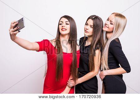 Three Models In Dresses Make Selfie.