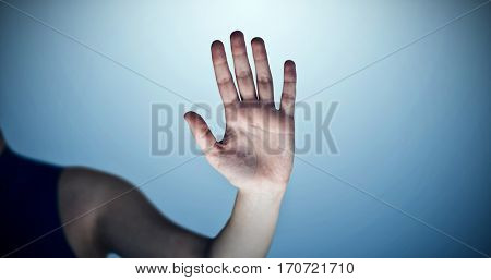 Hand of woman touching invisible screen against purple vignette