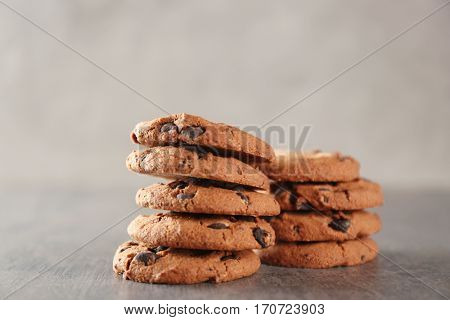 Delicious cookies with chocolate crumbs on grey table
