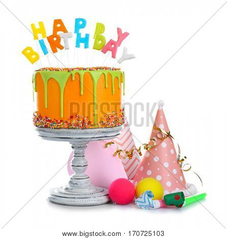 Delicious cake with happy birthday letter-shaped candles isolated on white