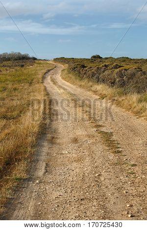 Gravel road throught dry Australian landscape