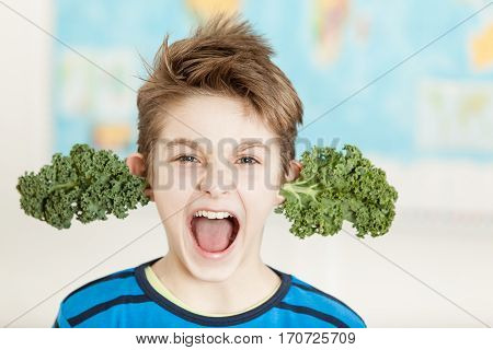 Boy Sprouting Fresh Kale Leaves From His Ears