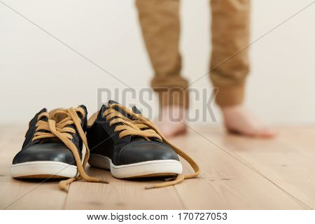 Pair Of Clean Lace Up Sneakers On The Floor