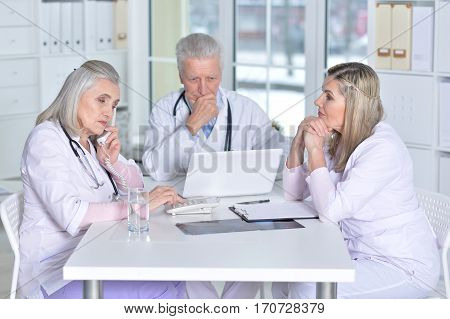 Portrait of a doctors discussing something in cabinet