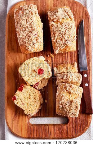 Cherry mini loaves with streusel sliced on board overhead
