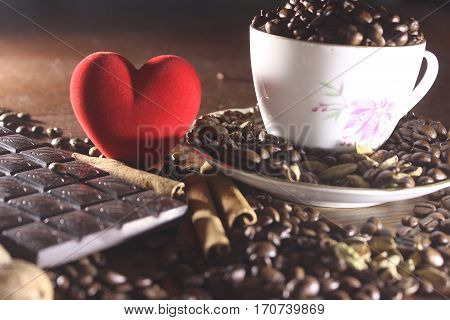 Coffee in a cup and saucer on a wooden background