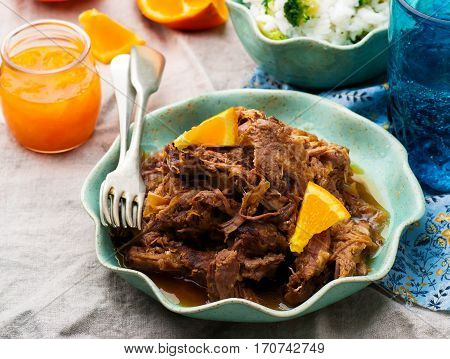 Slow Cooker Braised Pork with a Rum-Orange Sauce.selective focus