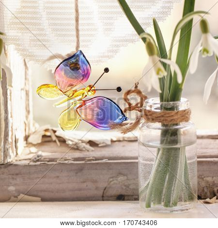 Iterior Window With Glass Butterfly And Snowdrops