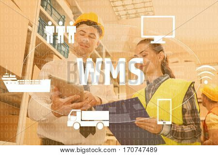 Warehouse management system concept. People working at factory facility