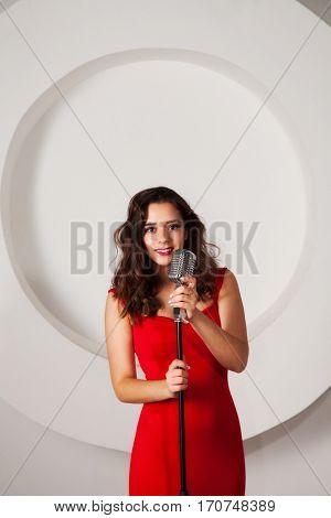 Beautiful brunette in formal red dress