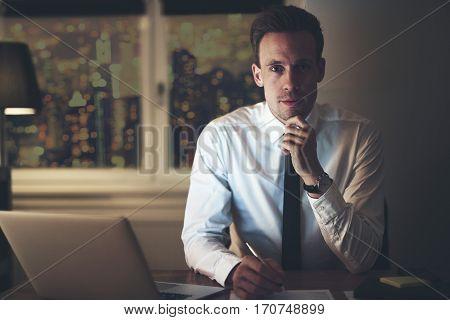 Portrait Of Serious Positive Businessman