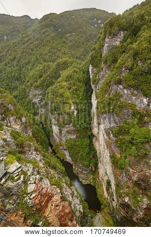 View from the tall arch dam at Lake Gordon, in Tasmania, Australia