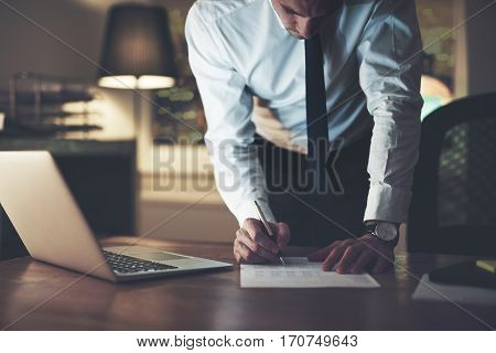 Serious Businessman Signing Contract