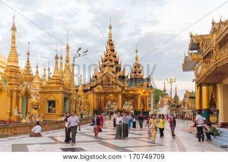 RANGOON, MYANMAR - JANUARY 18, 2017 : Tourists and devotee at the Shwedagon pagoda in Rangoon (Yangon), Myanmar