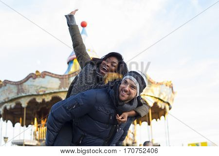 Couple in a date in an amusement park in Valentines Day