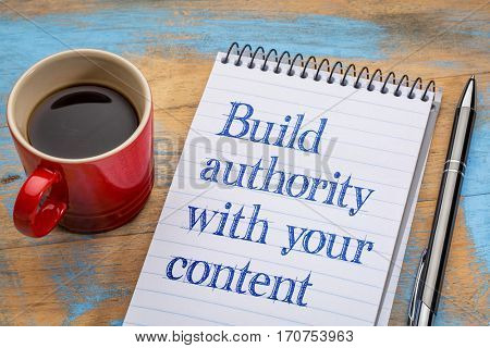 Build authority with your content , blogging tip - handwriting in a spiral notebook with a cup of coffee