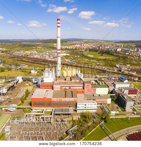 Aerial view of modern combined heat and power plant. Big chimney with sulphur removal unit. Heavy industry from above. Power and fuel generation in Czech Republic, European Union