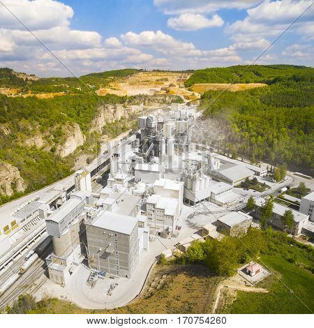 Biggest Czech limestone quarry Certovy Schody. Significant source of air pollution. Aerial view of industrial landscape after mining. Industry and environment in Czech Republic, Europe.