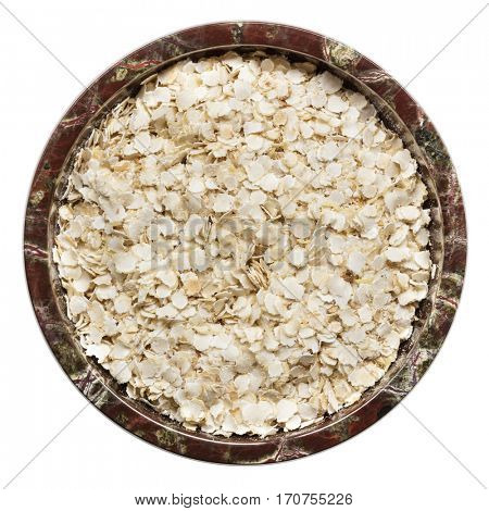 Quinoa isolated.  Flakes in small bowl, top view.