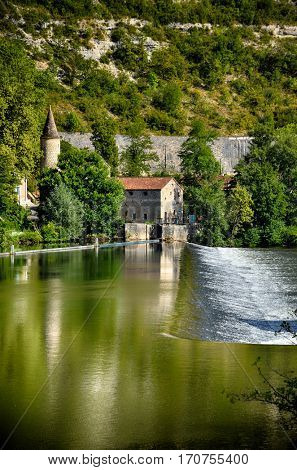 Cahors, medieval village on Lot river, France. Watermill detail