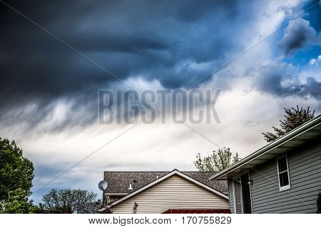 Thunderstorm clouds over suburban houses poster